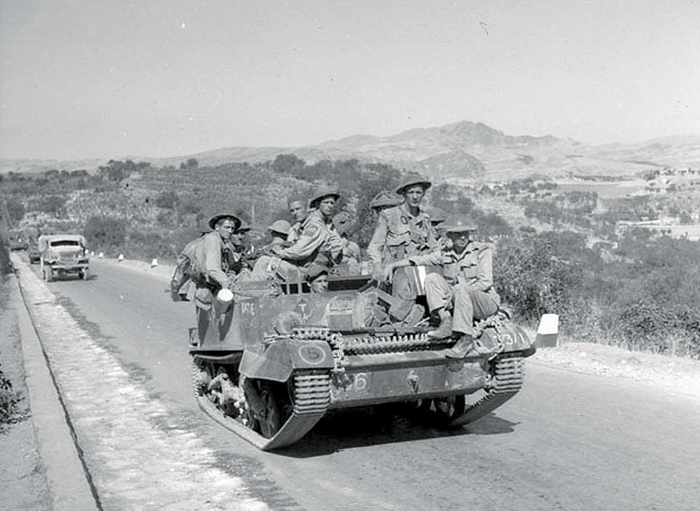 Infantrymen riding on tank.