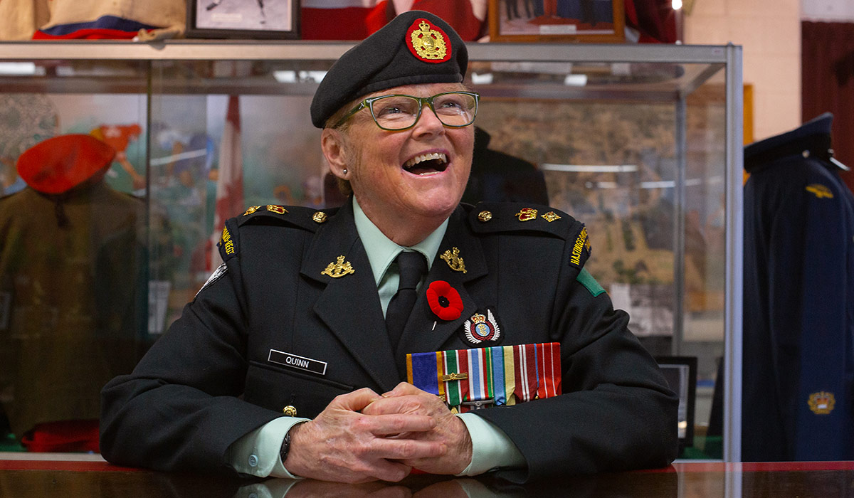 Lee-Anne in uniform behind a desk.