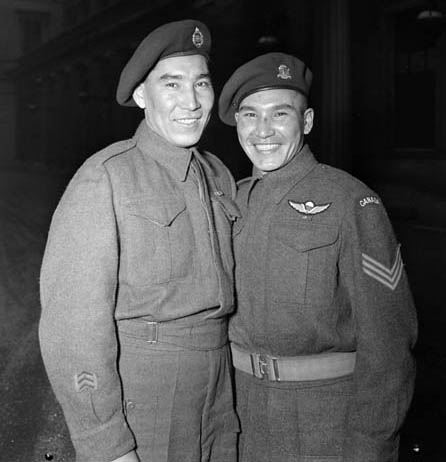 Tommy Prince (right) with a brother at Buckingham Palace, where he was awarded two gallantry medals.